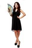 Spanierin mit einem Fan und einem schwarzen Kleid Stockbilder