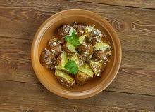 Spanisch gebratener Kartoffel-Salat lizenzfreie stockbilder