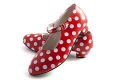 Spanisch sprenkelt rote weiße Schuhe Stockbild