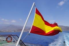Spanische Flagge auf einem Mast Stockfotos