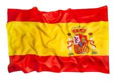 Spanische Flagge der Seide wellenartig bewegend auf weißen Hintergrund Lizenzfreies Stockfoto