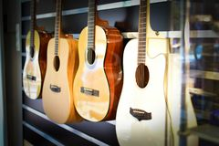 Spanish acoustic guitars hanging on the wall at a music store stock image