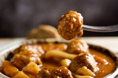 Spanish albondigas con sepia, meatballs with cuttlefish Royalty Free Stock Photography