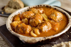 Spanish albondigas con sepia, meatballs with cuttlefish Royalty Free Stock Image