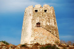 Spanish ancient tower in the coast with vivid blue sky back. For tourism Stock Photography