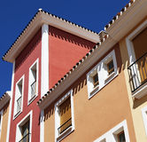 Spanish apartments, pastel colours and balconies. Stock Photos