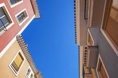 Spanish apartments, pastel colours and balconies. Royalty Free Stock Image