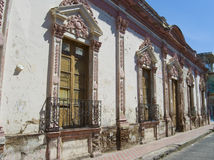 Spanish architecture. Looking down a small street in a small town, Mexico Royalty Free Stock Photos