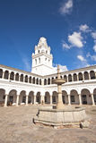 Spanish archway in Bolivia. View of the campanile of San francisco Xavier University in Sucre, Bolivia, with its patio's archway and fountain Royalty Free Stock Images