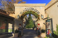 Spanish Arts Village Entrance Gate in Sedona Arizona. Entrance Gate to Trendy Tlaquepaque Outdoor Spanish Arts Village with decorated Christmas Tree in the royalty free stock photos