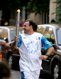 Spanish athlete Fermin Cacho carries the Torch Royalty Free Stock Photography