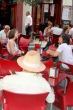 People enjoy in Spanish atmosphere at a dynamic terrace in Valencia, Spain Royalty Free Stock Images