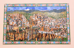 Spanish azulejo of the town of Ronda, Andalusia. Example of an azulejo, a form of Portuguese or Spanish painted, tin-glazed, ceramic tilework, depicting the city Royalty Free Stock Photos