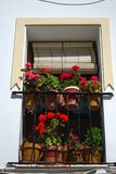 Spanish balcony with flowers, Ronda, Spain. Royalty Free Stock Image