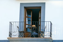 Spanish balcony with table and chairs Stock Image