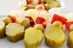 Spanish banderillas, skewers with pickles Royalty Free Stock Photos