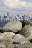 Spanish Banks, with Vancouver skyline behind. Rock pile at Spanish Banks, with Vancouver skyline behind royalty free stock photography