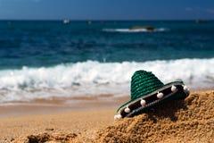 Spanish beach. With green sombrero stock photos