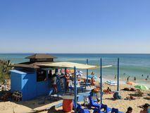Spanish beach bar in summer. Typical Spanish beach bar in summer with tourists enjoying the sun and the sea Stock Photography