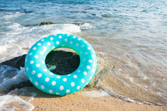 Spanish beach. Landscape Spanish Costa Brava beach with inflatable toys Royalty Free Stock Images