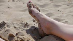 Spanish beaches in Catalonia. Feet of a tourist.