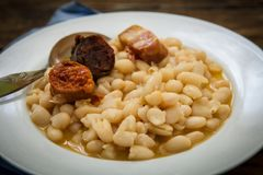 Spanish beans fadaba dish. Fabada is a typhical spanish legumes dish with big beans and sausage Stock Photography