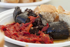 Spanish Blood Sausage Grilled Served with Roasted Red Peppers and Fresh Bread stock photo