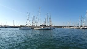 Spanish Boats in Marina Valencia. View of the yachts in the port from a pleasure boat. Yacht club in Spain stock video footage