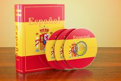 Spanish book with flag of Spain and CD discs on the wooden table. 3D Stock Photos