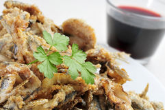 Spanish boquerones fritos, fried anchovies typical in Spain Royalty Free Stock Images