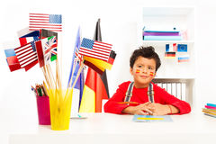 Spanish boy learning geography sitting at the desk. Cute Spanish schoolboy learning geography sitting at the desk in the classroom stock photography