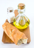 Spanish bread with oil and salt on wooden board Stock Image
