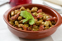 Spanish broad bean stew with serrano ham Royalty Free Stock Photo