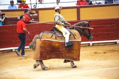 Spanish bullfight. Picador with a spear on a horse.The enraged bull attacks the bullfighter. Spain 2017 07.25.2017. Vinaros Monume. Picador with a spear on a stock photo