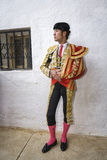 Spanish bullfighter Cesar Jimenez in the alley waiting at the pa Royalty Free Stock Photo