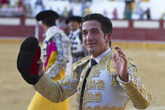 Spanish Bullfighter Curro jimenez to the turning of honour with a mntera in his hand Royalty Free Stock Image