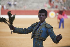 The Spanish Bullfighter David Galvan to the turning of honour with a bouquet of Rosemary in his hand Stock Photography
