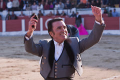 The Spanish Bullfighter Jose Ortega Cano to the turning of honour with an ear in his hand. Linares, province of Jaen, Spain, 14 march 2010 Royalty Free Stock Photo