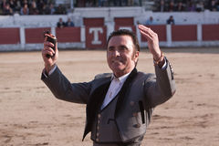 The Spanish Bullfighter Jose Ortega Cano to the turning of honour with an ear in his hand. Linares, province of Jaen, Spain, 14 march 2010 Royalty Free Stock Image