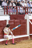 Spanish bullfighter Juan Jose Padilla sitting in the burladero with two flags in the right hand, as in the past is to, in the last royalty free stock images