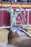 The Spanish Bullfighter Manuel Escribano putting flags during a. Sabiote, Spain - August 23, 2014: The Spanish Bullfighter Manuel Escribano putting flags during stock photo