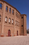 Spanish bullring. Exterior of traditional Spanish bullring with blue sky background Stock Photo