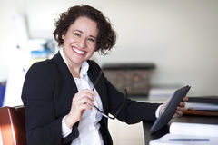 Spanish Businesswoman Smiling At the Camera. At the office. royalty free stock photos