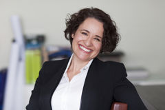 Spanish Businesswoman Smiling At the Camera. At the office. Royalty Free Stock Image