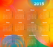 Spanish Calendar for 2015 on abstract circles. Mondays first Stock Photography