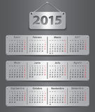 2015 Spanish calendar. Calendar for 2015 in Spanish with attached metallic tablets. Vector illustration Royalty Free Stock Photo