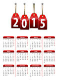 Spanish calendar for 2015 year with red hanging glossy tags. Mondays first. Vector illustration Stock Illustration