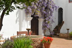 Spanish-Californian Courtyard. The redbrick courtyard fountains and wisteria trellis of the Spanish Californian San Luis Rey Mission Royalty Free Stock Photography