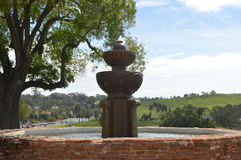 Spanish-Californian Mission Fountain. A small, red-brick fountain in the Spanish Californian San Luis Rey Mission Stock Photos