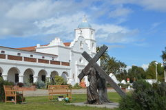 Spanish-Californian Mission San Luis Rey. A statue of a Cross in front of the Spanish-Californian Mission San Luis Rey Royalty Free Stock Image